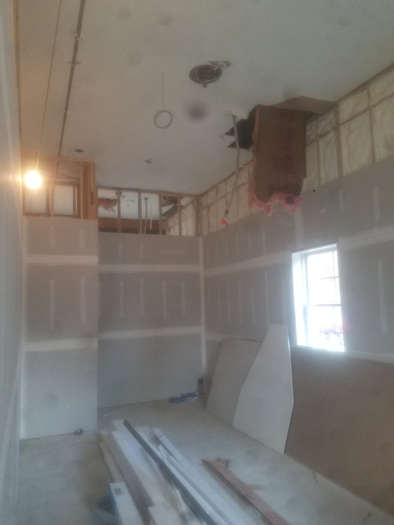 UNFINISHED HOME SHOWING ELECTRICAL WORK BEING DONE BY ELECTRICIAN