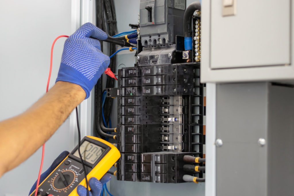 Electrician-in-the-building-testing-fuse-box