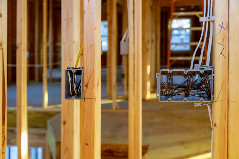 Electrical-socket-boxes-with-wires-of-wooden-beams-in-a-wall