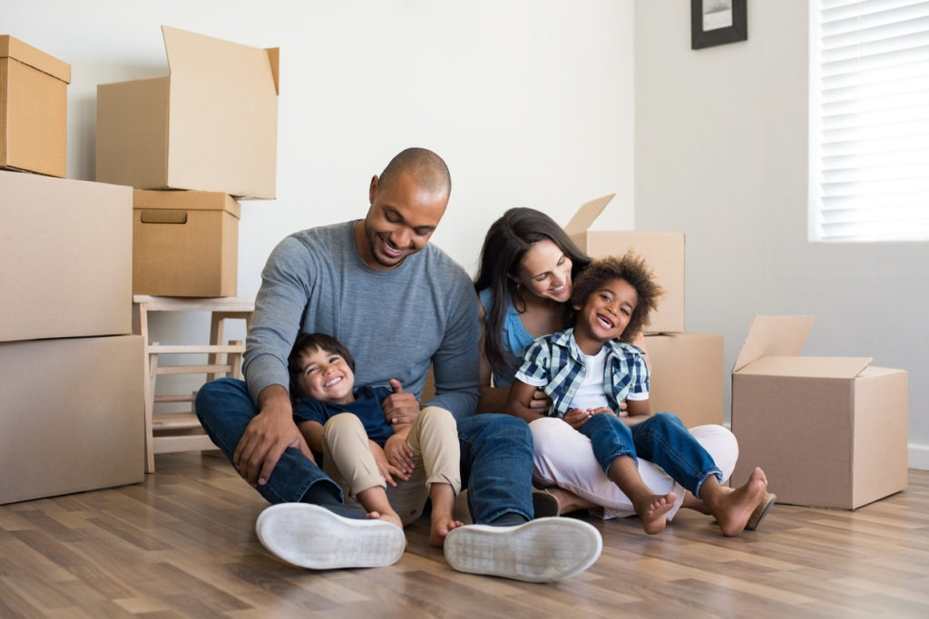 Multiethnic family moving home
