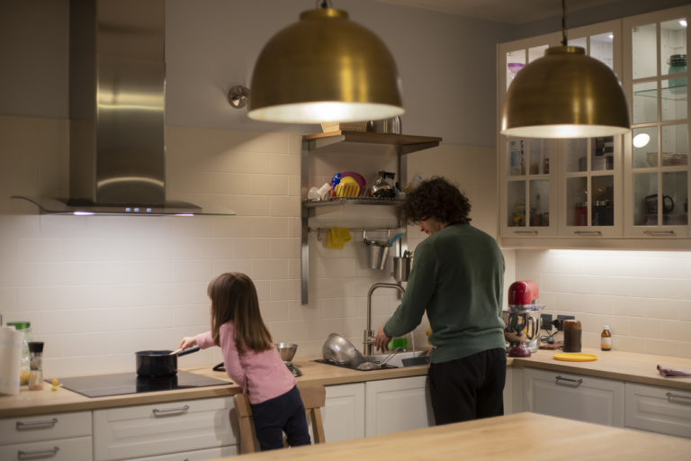 father-and-little-child-girl-back-view-cooking-together